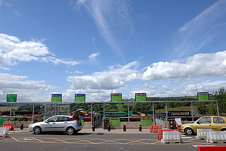 A photo of a number of large skips at a household waste and recycling centre