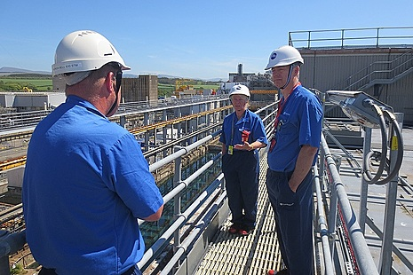 Martin Chown meeting employees on the gantry in FGMSP