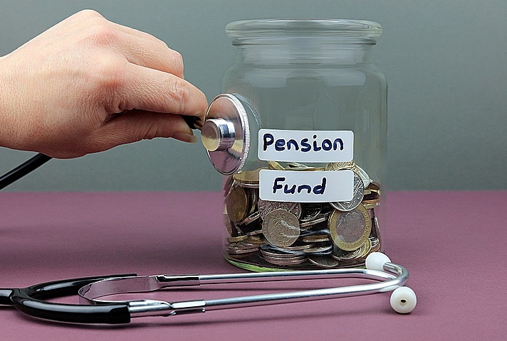 Stethoscope against a jar of money with pension fund label