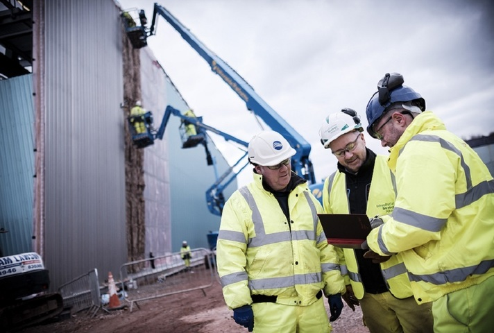 Image of the construction site with Sellafield employees in the foreground