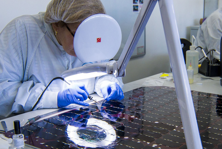 A worker with spacecraft solar panel