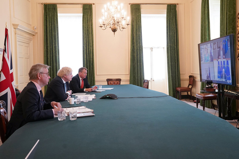 The Prime Minister Boris Johnson inside the Cabinet Room of No10 Downing Street joined by Europe Adviser and Chief Negotiator of Task Force Europe David Frost and Minister for the Cabinet Office Michael Gove.