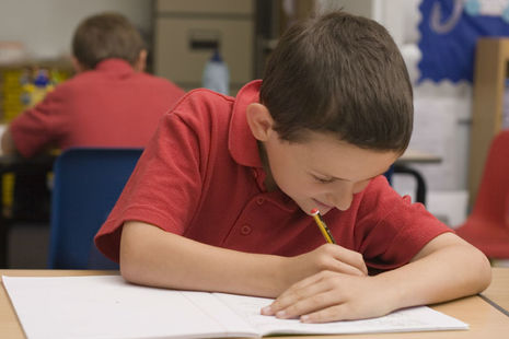 Pupil working in classroom