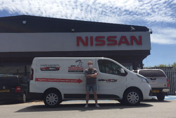 The new Nissan NV300 for the Walking With the Wounded charity van and a man standing in front of looking straight at the camera