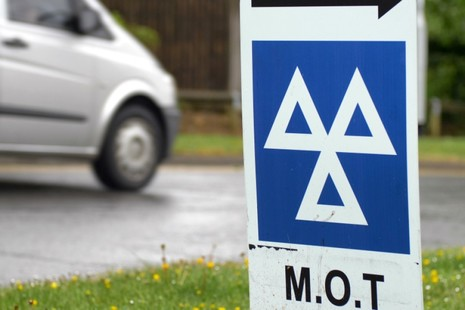Photo of an MOT centre sign at the roadside.