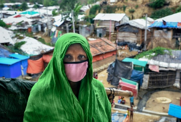 A Rohingya refugee woman wears a mask to protect against coronavirus in a camp in Cox's Bazar, Bangladesh