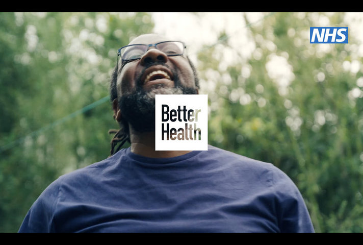 Smiling man and Better Health logo