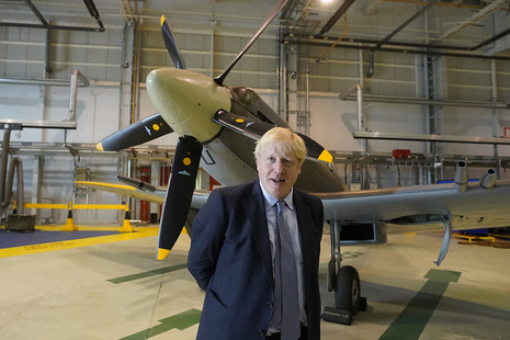Prime Minister Boris Johnson stands alongside a Spitfire at RAF Lossiemouth, Moray, as part of his tour of Orkney and the Highlands.