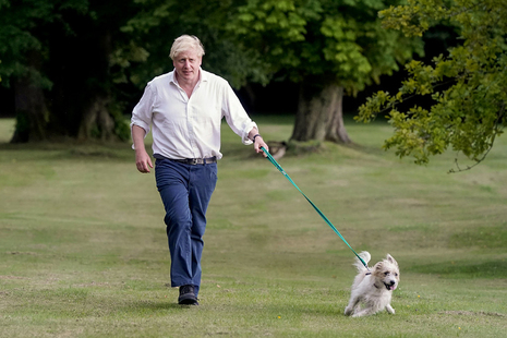 Prime Minister Boris Johnson takes his dog Dilyn for a walk in the grounds of Chequers as he encourages people to exercise for a better health.