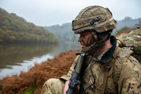 Soldier looks out over river