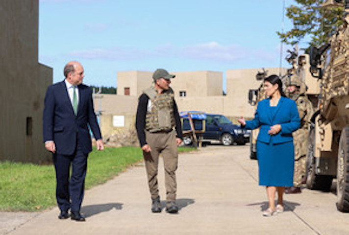 Defence Secretary Ben Wallace and Home Secretary Priti Patel speak to an Afghan interpreter at Wretham Camp in Thetford.