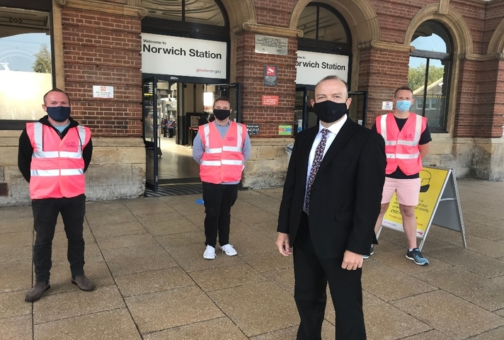 Chris Heaton-Harris with Journey Makers outside Norwich station.