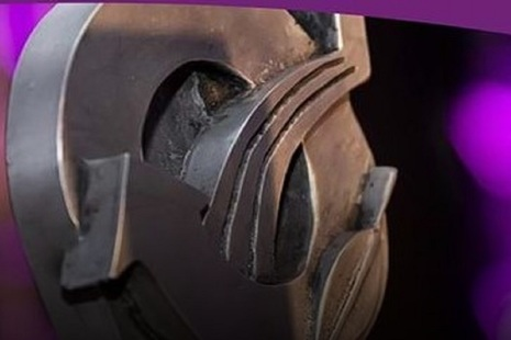 Close up image of a piece of steel work on a purple background replicating the IChemE awards