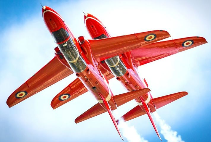 Pictured are two aircraft of the Red Arrows Aerobatic Team flying The Synchro Pair.