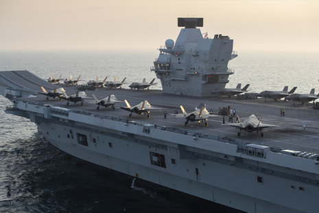 Image depicts the HMS Queen Elizabeth aircraft carrier.