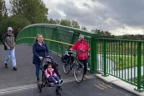 local residents cross the new bridge