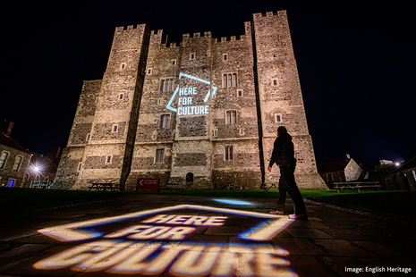 Here for Culture logo projected onto Dover Castle at night
