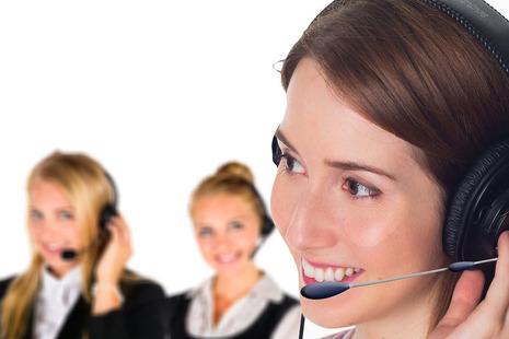 Women talking into a headset