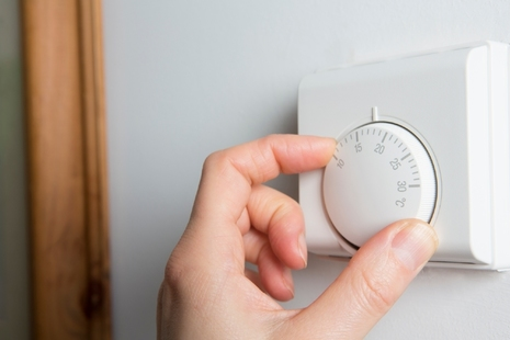 Hand adjusting thermostat.