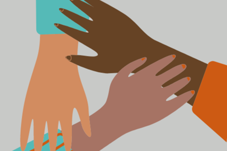 Three hands of different ethnicities touching