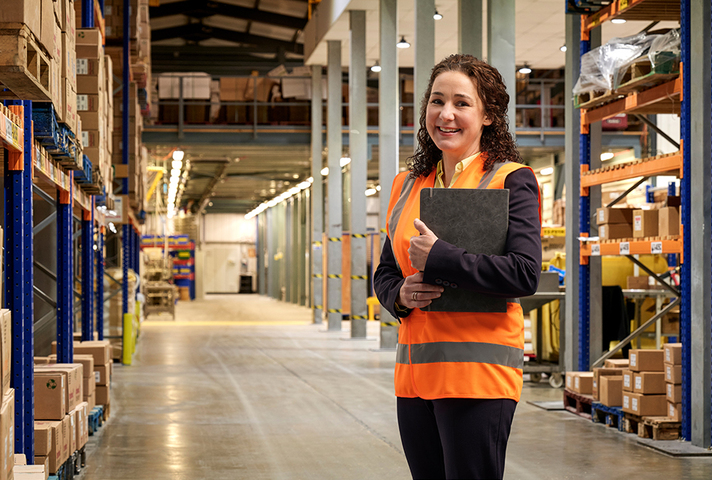 UKEF export finance manager in a warehouse