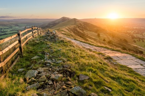 A_stone_footpath_and_wooden_fence_leading_a_long_The_Great_Ridge_in_the_English_Peak_District.__GettyImages-609794534__2_