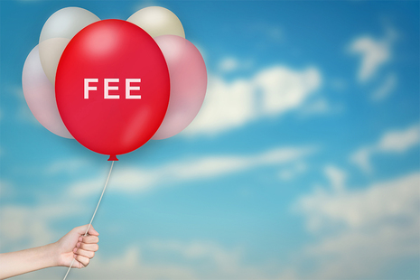 Blue sky with balloons attached to a string and a red balloon displaying the word fee