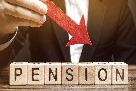 arrow pointing to pension written in wooden blocks