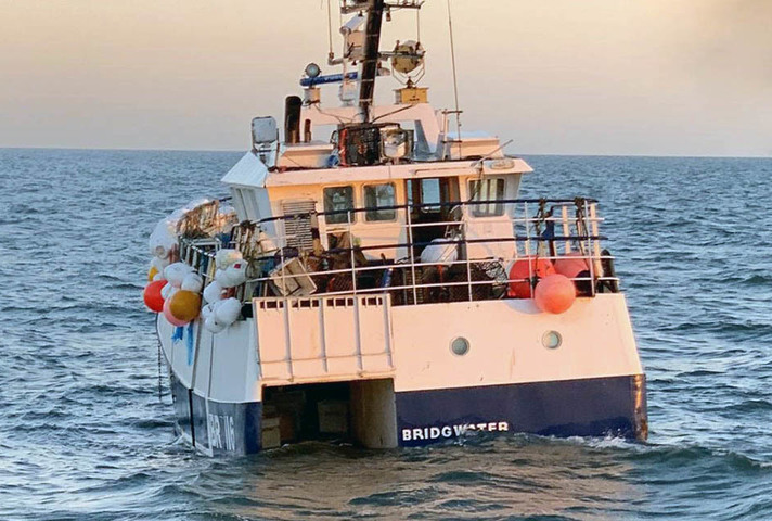 The fishing vessel low in the water after the accident