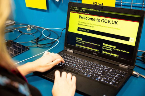 GOV.UK homepage on a laptop in the GDS Accessibility Empathy Lab in high contrast yellow and black.