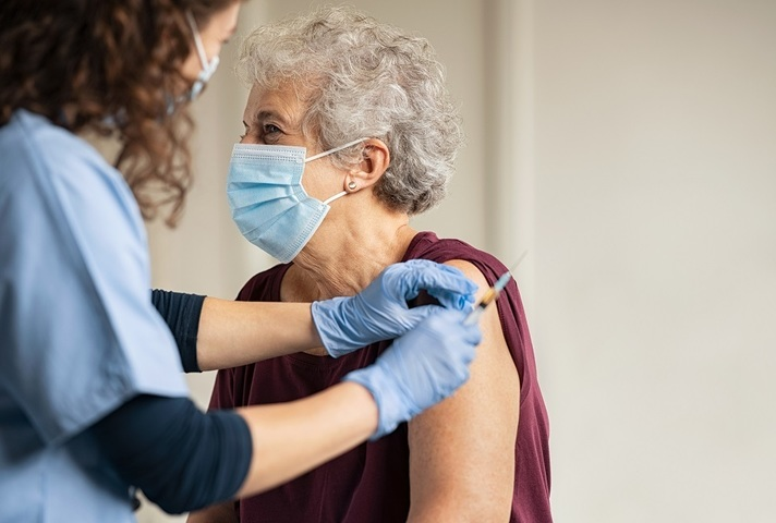 Older woman getting a COVID-19 vaccination