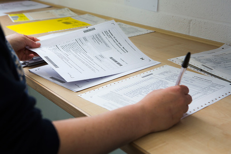 Person marking exam papers
