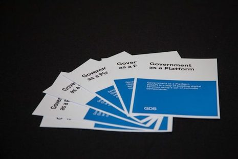 Five blue and white Government as a Platform (GaaP) leaflets fanned out on a black background.