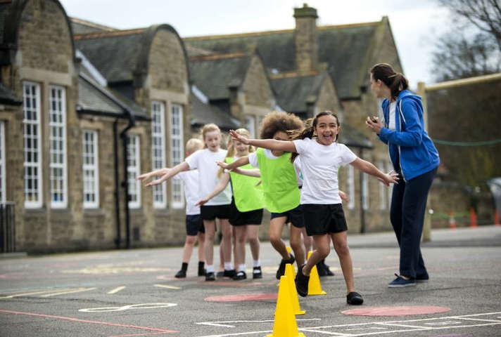 Children having PE lesson in school playground