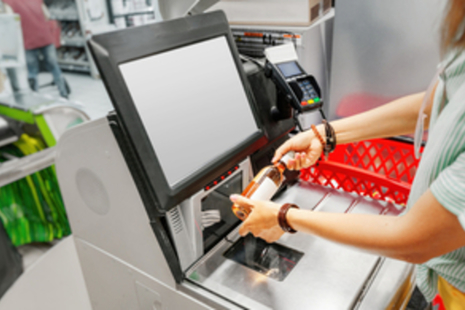 Female scanning an item at a checkout