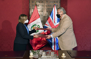 Ambassador Kate Harrisson with Peru's Foreign Minister Allan Wagner during the signing ceremony.