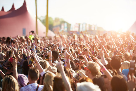 Image shows a large crowd at a festival
