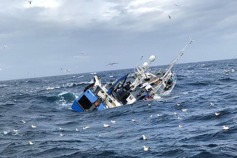 Fishing vessel Ocean Quest listing heavily to starboard and sinking