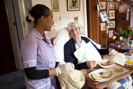 Carer with an older lady in a care home