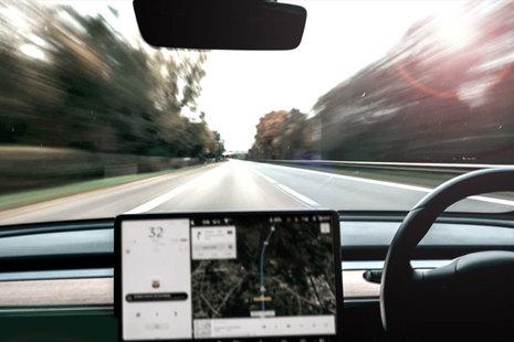 View of a road through a car windscreen.