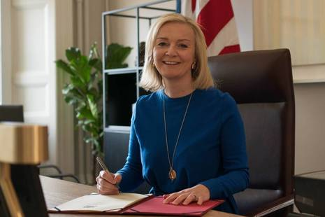 Liz Truss signing Trade Act