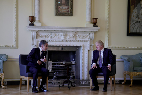 Prime Minister Boris Johnson sitting with US Secretary of State Antony Blinken