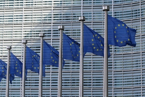 European Union flag in front of the European Commission building