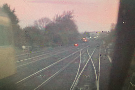 CCTV image from the rear of the train of empty coaches, showing the rail grinding train, travelling towards the junction, on the left (courtesy of East Midlands Trains)