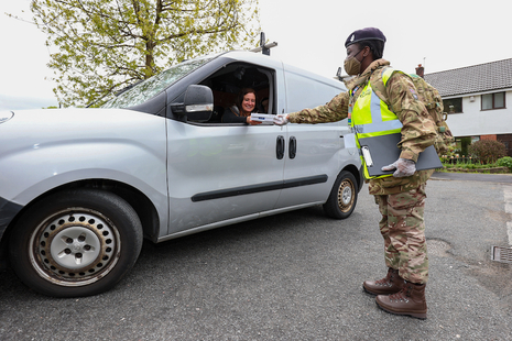 Military person helping with testing