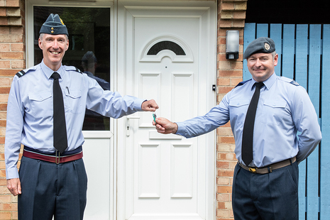 Air Cdre James Savage (left) presents the keys to a new SFA home at RAF Waddington, upgraded under Project Speed, to Chf Tech Brindley. This is the first RAF move in under Project Speed. (MOD Crown Copyright)