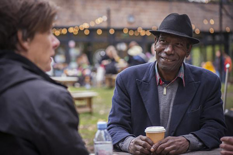 Two men chatting and drinking coffee