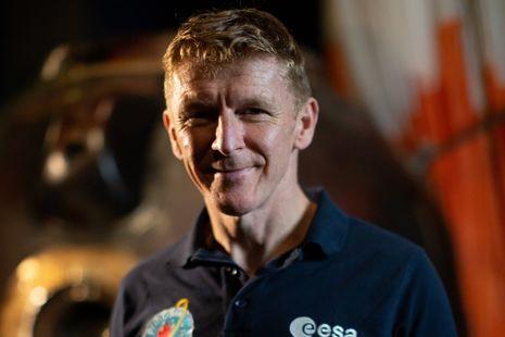 Tim Peake in front of his Soyuz capsule on display at the Science Museum