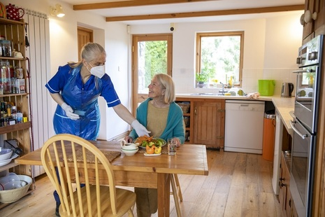 Homecare worker and client at home