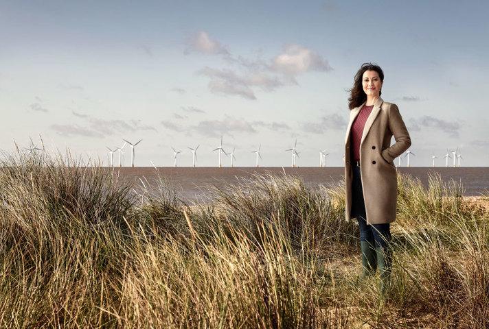 UKEF employee standing on a windfarm